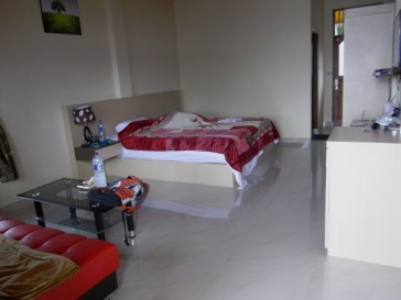 This is a pretty spacious, breezy, clean and bright room. I liked it because it had plenty of natural light.